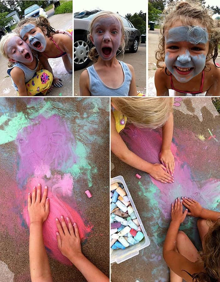 Two girls laughing while creatively coming up with chalk art ideas, like painting their faces with wet chalk.