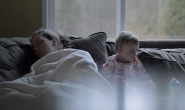 An Exhausted Mom Falls Asleep — Her Little One's Reaction Nearly Had Me in Tears
