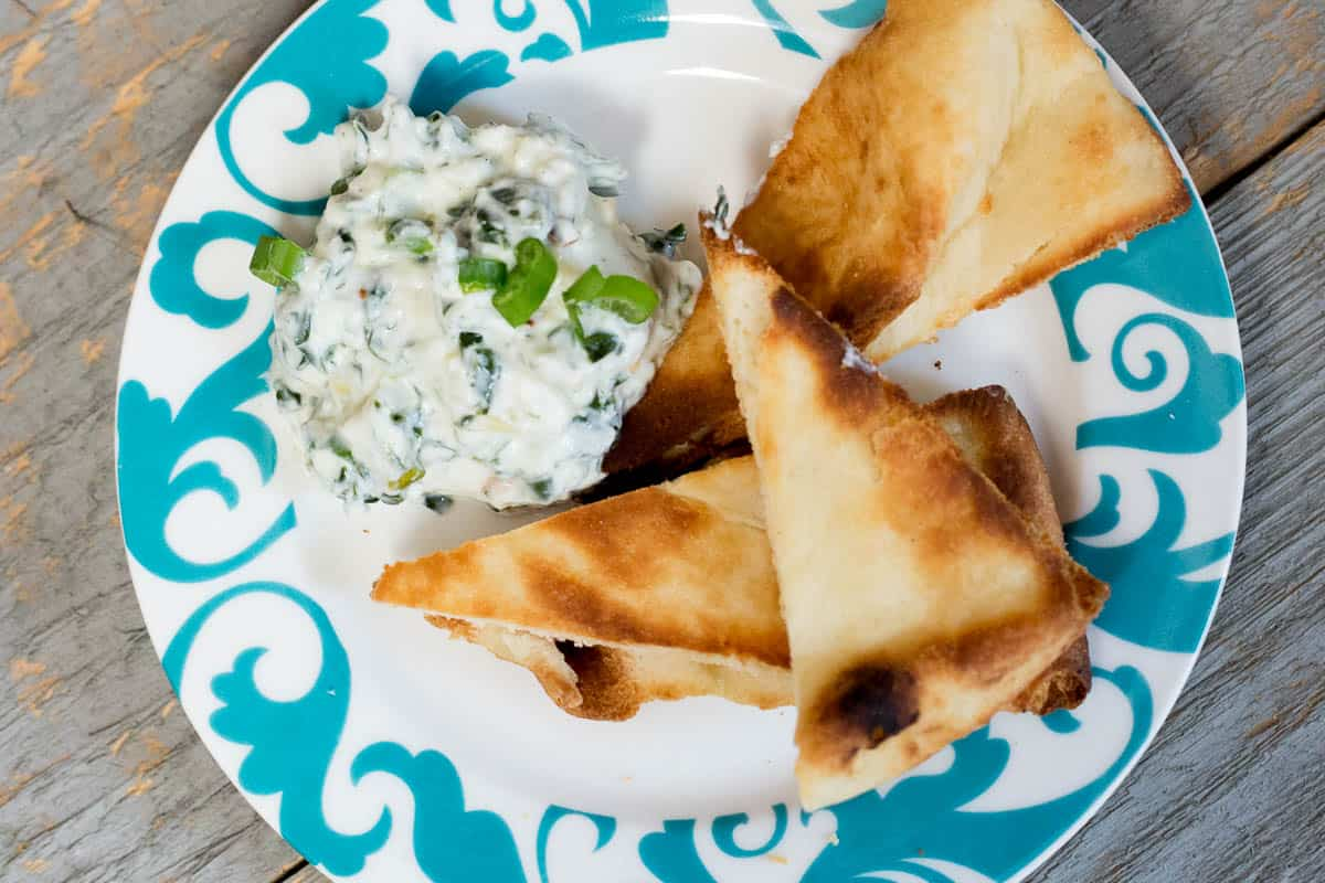 This Spicy Spinach Dip (made with Greek Yogurt) sounds insanely delicious *Pinning this for our next party