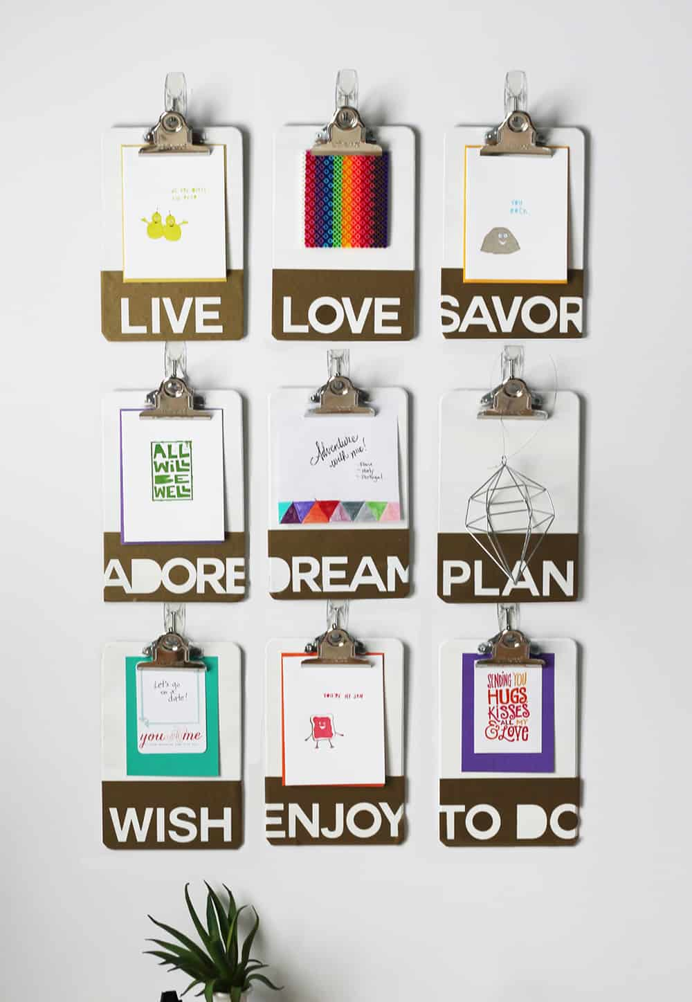 This clipboard inspiration wall is perfect for teen bedrooms and college dorms *I love how they use temporary hooks with this clipboard gallery, so there are no nail holes in the wall