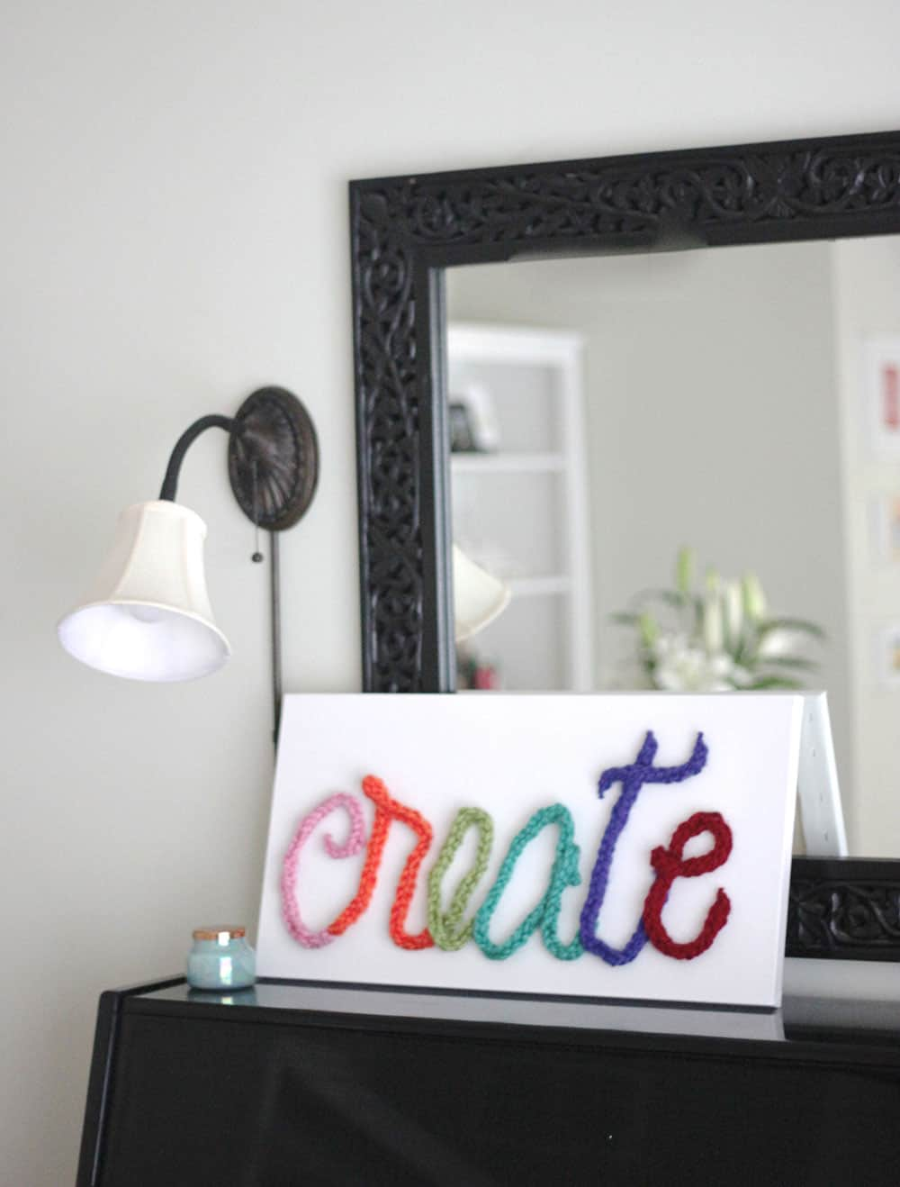 Sign art using finger knitting