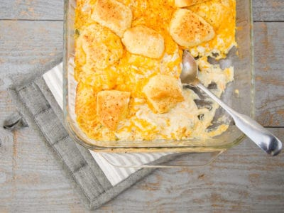 This cheesy chicken pot pie biscuit casserole is SO GOOD. If you're pinched for time, keep this 30-minute cheesy chicken biscuit casserole simple with ingredients from your pantry. This quick and easy chicken bake uses cream of chicken soup and sour cream, so it is amazingly creamy. *This is a keeper! My kids (and husband!) love it.