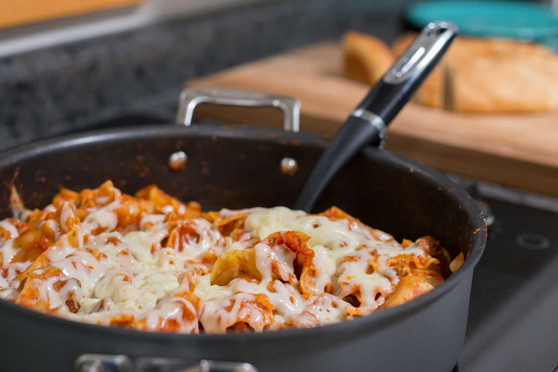 This 20-minute Cheesy Skillet Lasagna Recipe is simple to make on the stovetop. It has only three ingredients and you can make supper in one pot. *My family loves easy Italian food! This is perfect for a fast weeknight dinner.