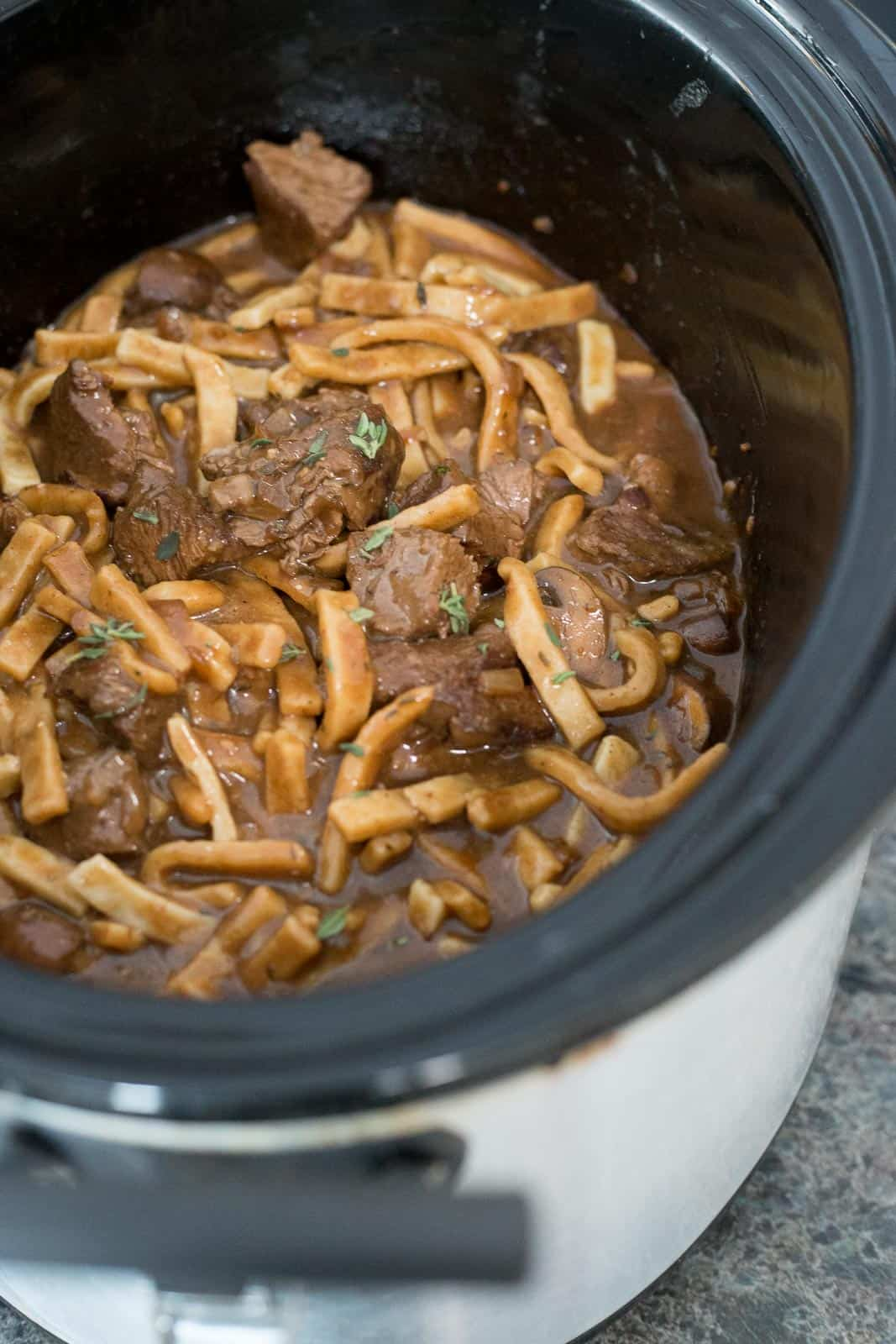 This slow cooker stroganoff is so simple and DELICIOUS, perfect for a chilly day. Just pop it in the crock pot and come home to a delicious family meal. #recipe #homemadegoodness #reames #ad #slowcooker #crockpot *My family loves Beef Stroganoff
