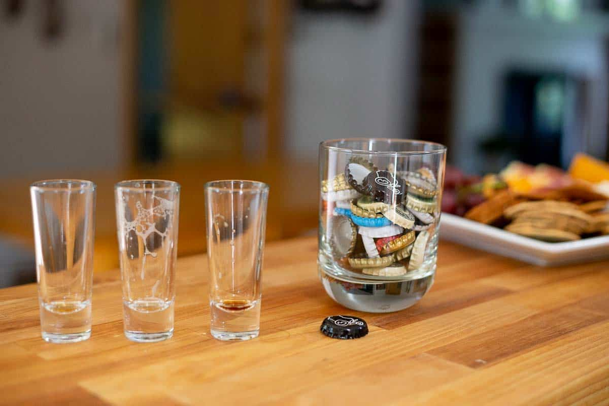 A collection of tall shot glasses work perfectly for beer sampler glasses. Friends and family can enjoy small samples and then pour themselves seconds (or thirds!) of their favorites. (If any of the craft beers you're offering have a citrus note, be sure to have orange or lemon wedges available too.) #craftbeer #beersampling #partyideas *loving these tips