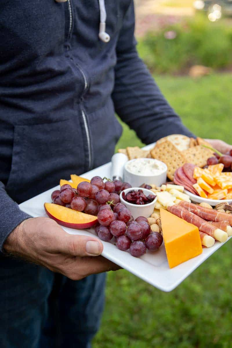 If you're hosting a seated, craft beer-tasting party in your backyard, consider showcasing the gourmet cheese platters as edible centerpieces. If you've set up a pre-dinner craft beer bar on the countertop, a Wisconsin cheese platter is perfect for on-the-go snack mingling. #craftbeer #beertasting #beer #beersampling #partyideas *loving this list of part ideas