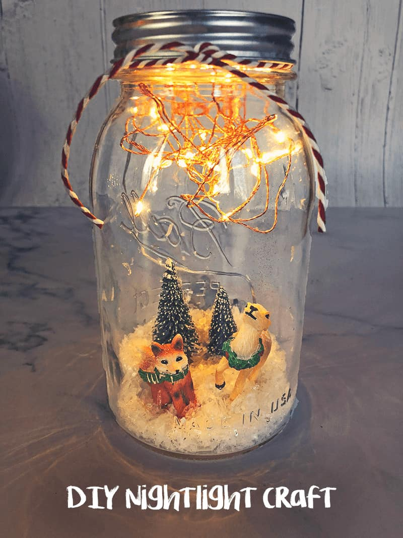 Christmas Crafts for Kids - DIY Snow Globes or awesome DIY Nightlight? That's up to you! Learn how to make this super simple craft that light up (and are water free) #kidscraft #christmascraft #DIY #holidayDIy *My kids love using their mason jar snow globe as a DIY night light