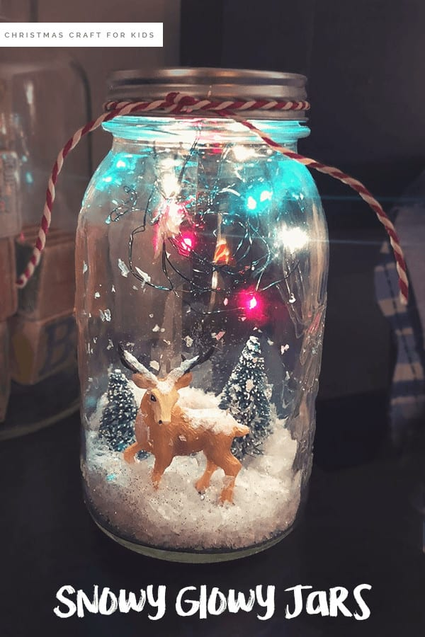 Christmas Craft for Kids - DIY Snow Globes For Kids: Learn how to make snow globes that light up (and are water free) #kidscraft #christmascraft #DIY #holidayDIy *My kids love using their mason jar snow globe as a DIY night light
