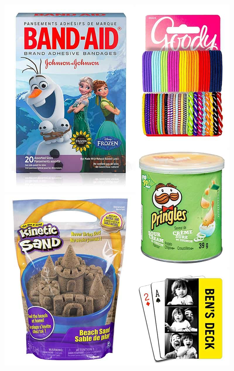 Stocking stuffers for kids including band-aids, hair ties, kinetic sand, pringles, and custom cards