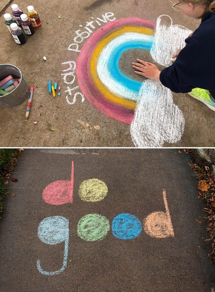 "Sidewalk chalk art showcasing positive messages including ""stay positive"" and ""do good."""