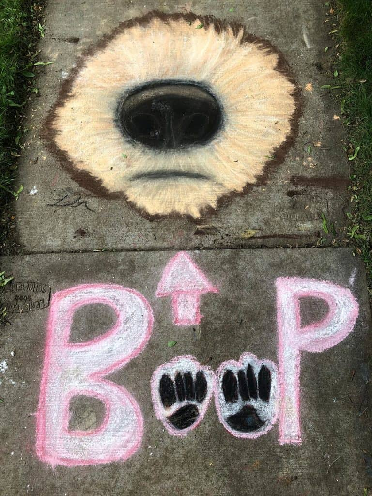 "sidewalk art showcasing the dog snout and the text ""boop"" my nose"