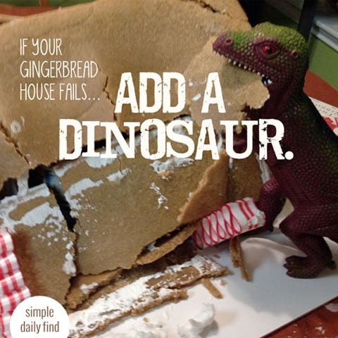 """A destroyed gingerbread house with a T-Rex and the following quote written over top, """"If your gingerbread house fails, add a dinosaur."""""""