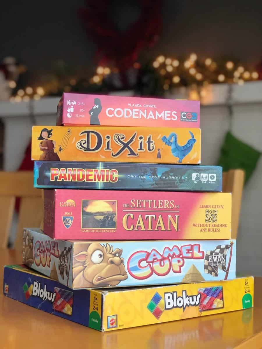 A stack of family board games.
