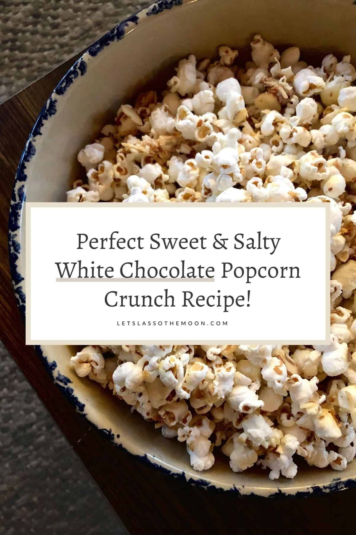 "A bowl of white chocolate popcorn with a headline written over top reading, ""Perfectly Sweet & Salty White Chocolate Popcorn Crunch Recipe."""